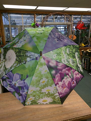 Umbrella with close-up flower photos printed on it
